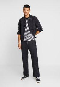 Weekday - IAN  - Pantalon de survêtement - black - 1