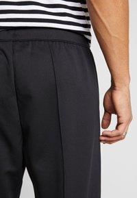 Weekday - IAN  - Pantalon de survêtement - black - 3