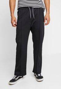 Weekday - IAN  - Pantalon de survêtement - black - 0