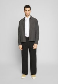 Weekday - MFON TROUSERS - Stoffhose - black - 1