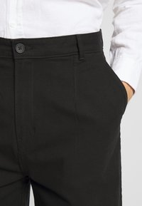 Weekday - MFON TROUSERS - Stoffhose - black - 5