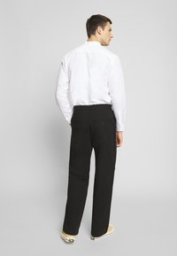 Weekday - MFON TROUSERS - Stoffhose - black - 2