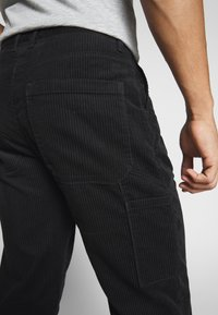 Weekday - DIMITRI TROUSERS - Trousers - black - 4