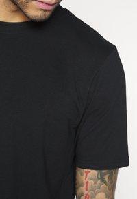 Weekday - FRANK - Basic T-shirt - black - 6