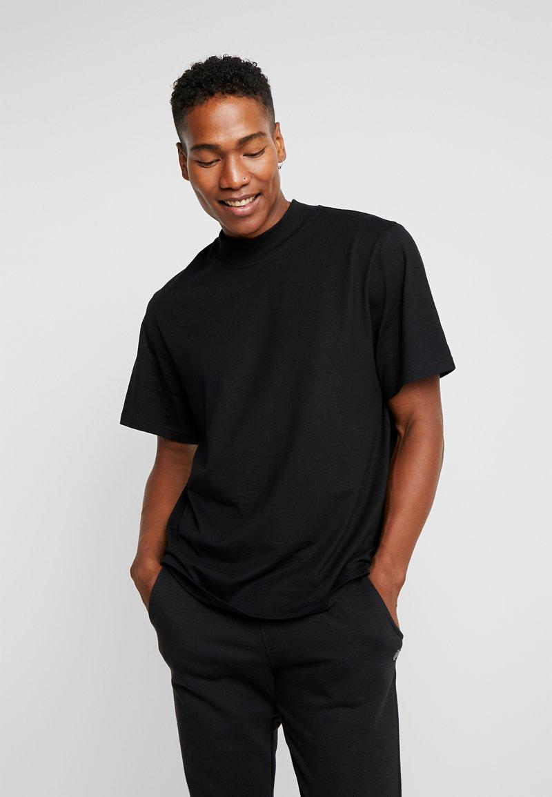 Weekday - URBAN MOCKNECK - T-shirt - bas - black