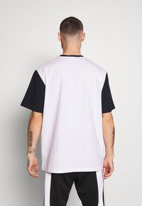 Weekday - ANDRE - T-shirt z nadrukiem - navy - 2