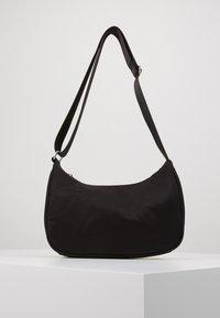 Weekday - ZARI HANDBAG - Across body bag - black - 0