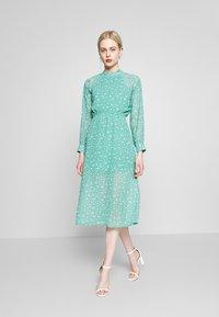 Wednesday's Girl - HIGH NECK ELASTICATED WAIST RAGLAN SLEEVE DRESS - Day dress - de-ja-vu green - 1