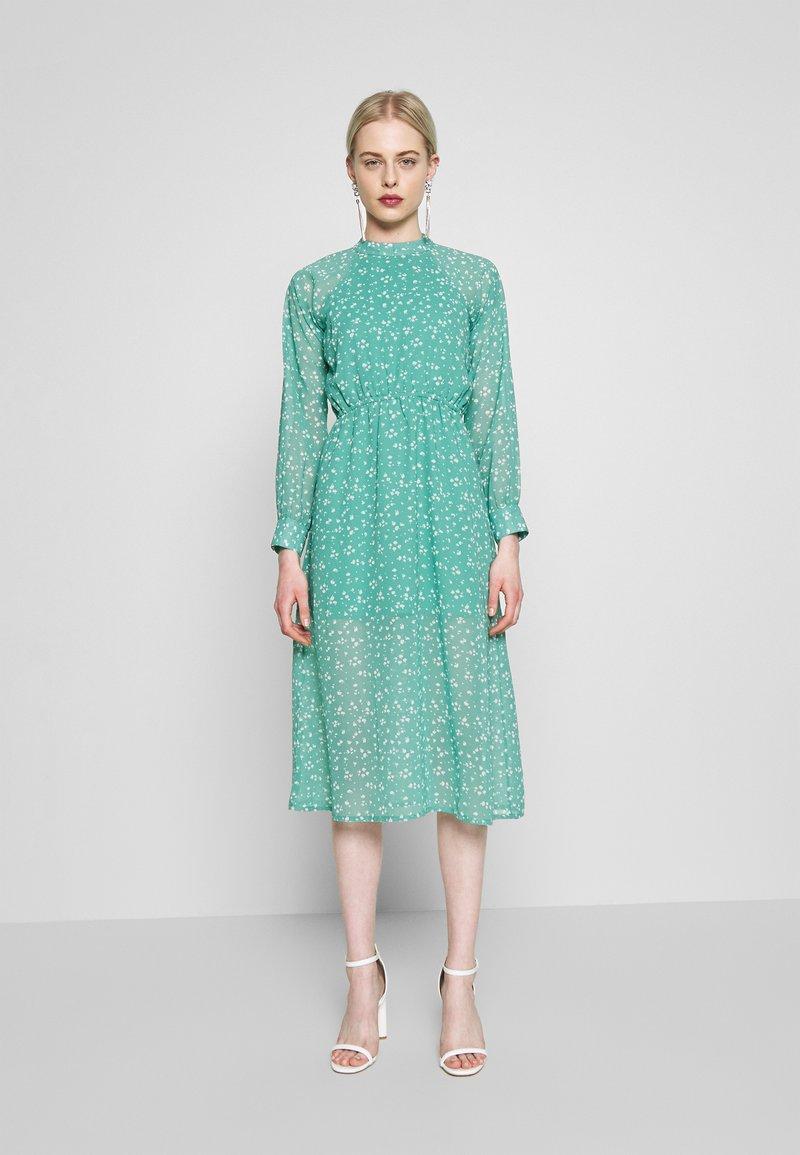 Wednesday's Girl - HIGH NECK ELASTICATED WAIST RAGLAN SLEEVE DRESS - Day dress - de-ja-vu green
