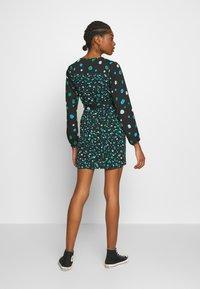 Wednesday's Girl - BALOON SLEVE WRAP MINI DRESS - Day dress - black/green spot - 2