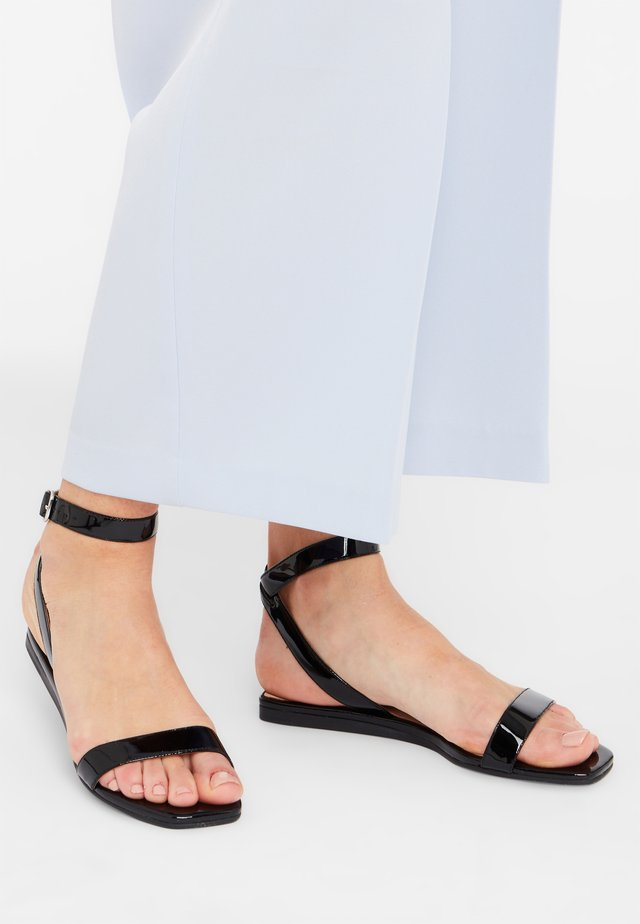 NELLIE - Ankle cuff sandals - black