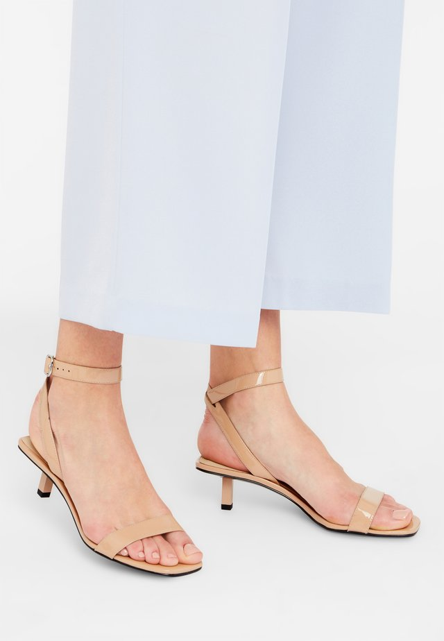 NELLIE - Ankle cuff sandals - nude