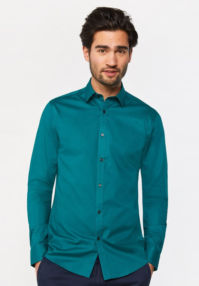 MIT STRETCHANTEIL - Shirt - green