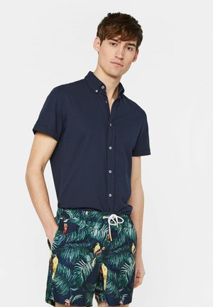 mit Muster - Swimming shorts - green