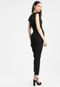 WAL G. - RUFFLE JUMPSUIT WITH BACK INSERT - Jumpsuit - black - 2