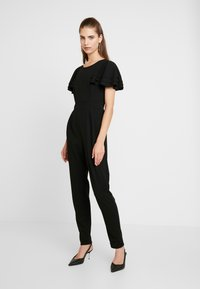 WAL G. - SHORT SLEEVE FRILL SHOULDER - Tuta jumpsuit - black - 0