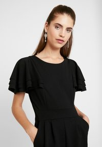 WAL G. - SHORT SLEEVE FRILL SHOULDER - Tuta jumpsuit - black - 3