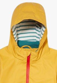 White Stuff - ALFIE RAIN  - Waterproof jacket - yolk yellow - 4