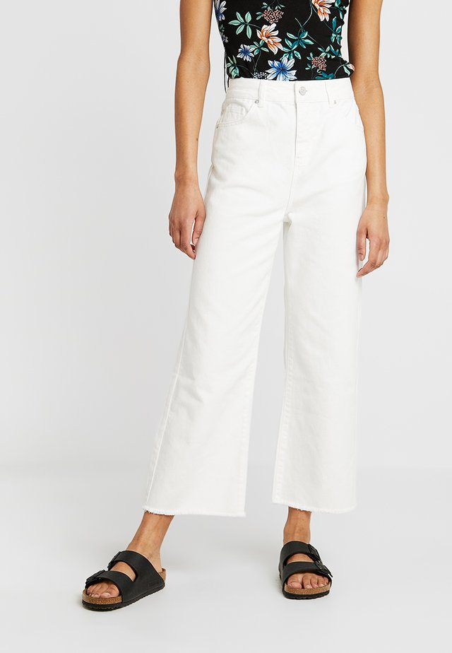 NINA ANCLE - Flared Jeans - white