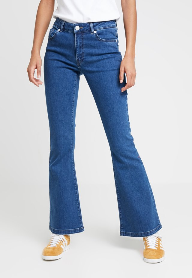 RIKA  - Flared jeans - mid blue