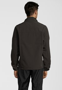Whistler - MIT WASSERSÄULE VON - Soft shell jacket - deep olive - 2