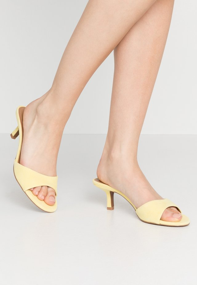 Heeled mules - bright yellow