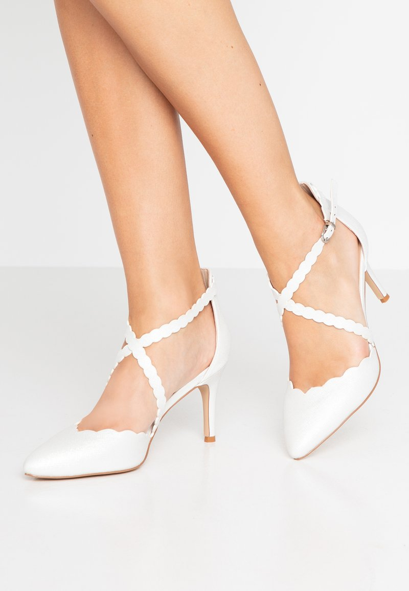 Wallis - CARTWHEEL - Pumps - white