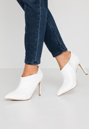 PRINCE - High heeled ankle boots - white