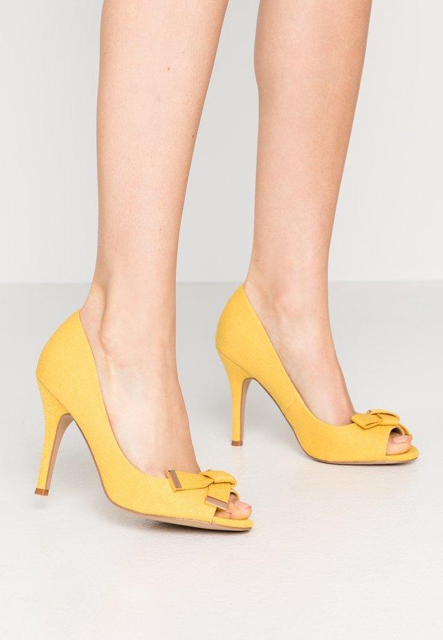 CELESTIA - Peeptoe heels - yellow