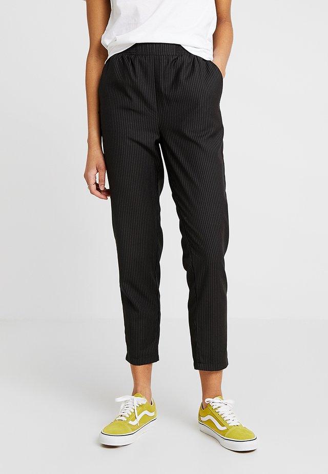 IRIS - Trousers - black/white