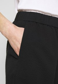 Wemoto - NIA - Trousers - black - 4