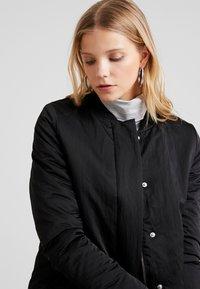 Wemoto - Krátký kabát - black - 4