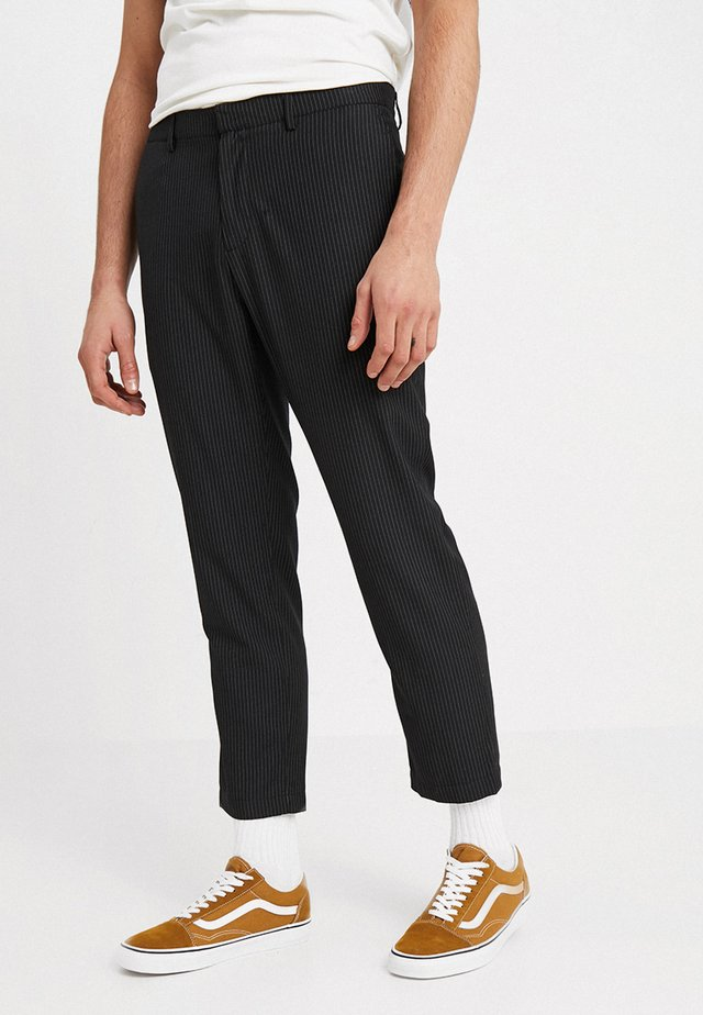 CHARLES - Trousers - black/white