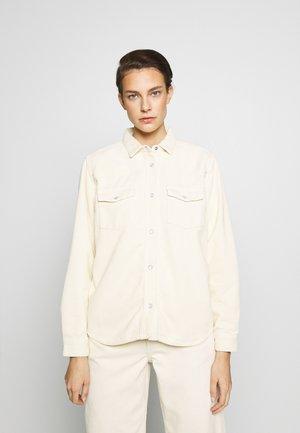 PERNILLA - Button-down blouse - seedpearl white
