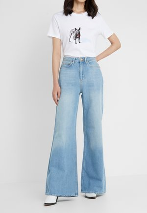 KIMMY - Flared jeans - used blue