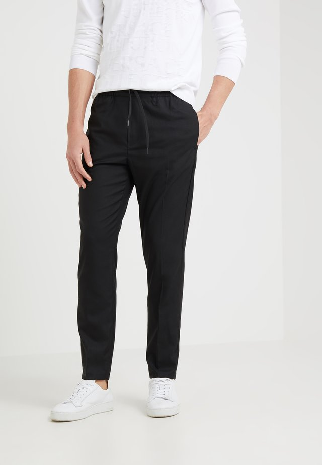 CLAVIN - Trousers - black
