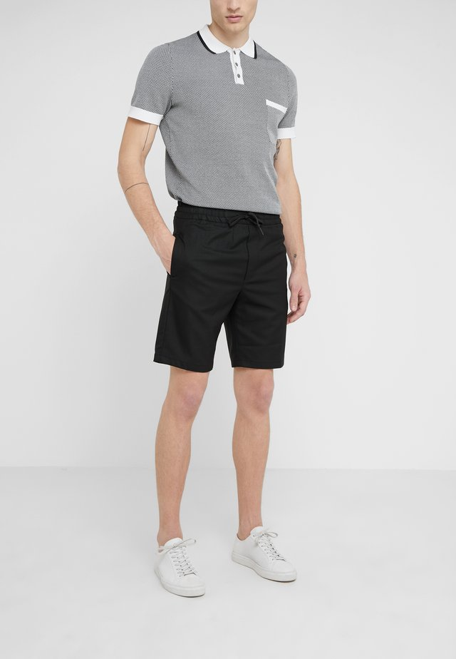 CALVIN  - Shorts - black