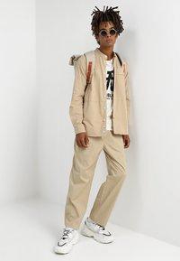Wood Wood - BUZZ TROUSERS - Trousers - beige - 1