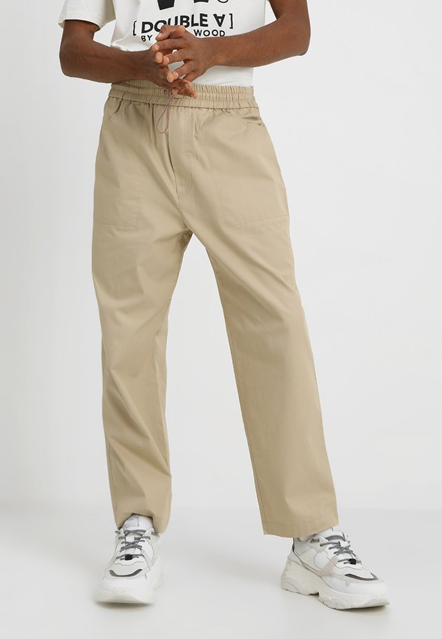 BUZZ TROUSERS - Trousers - beige