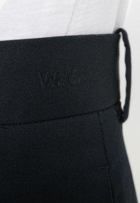 Wood Wood - TRISTAN TROUSERS - Trousers - black - 5