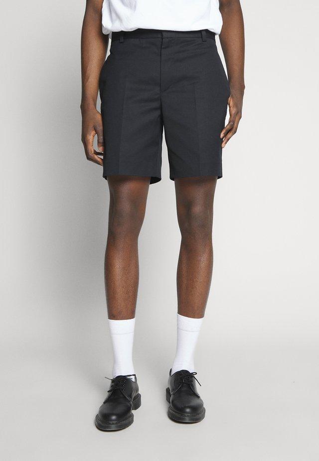 TOMI - Shorts - black