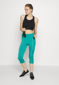 Wolf & Whistle - EXCLUSIVE CROPPED LEGGINGS WITH REFLECTIVE STRIPS - Punčochy - teal - 1