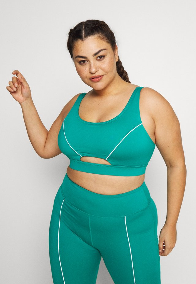 EXCLUSIVE CUT OUT BRA WITH REFLECTIVE STRIPS - Urheiluliivit - teal