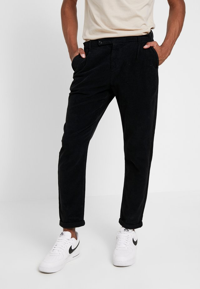 KLAUS CORD - Trousers - black