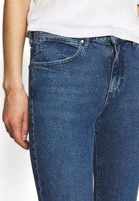 Wrangler - SLIM - Slim fit jeans - blue denim - 3
