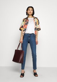 Wrangler - SLIM - Slim fit jeans - blue denim - 1