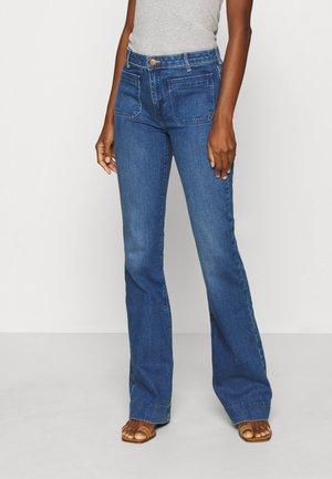Jeans a zampa - sunday blues