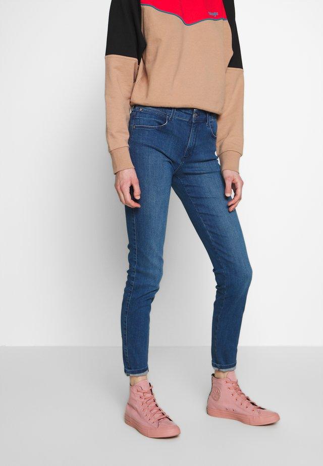 Jeansy Skinny Fit - true mid