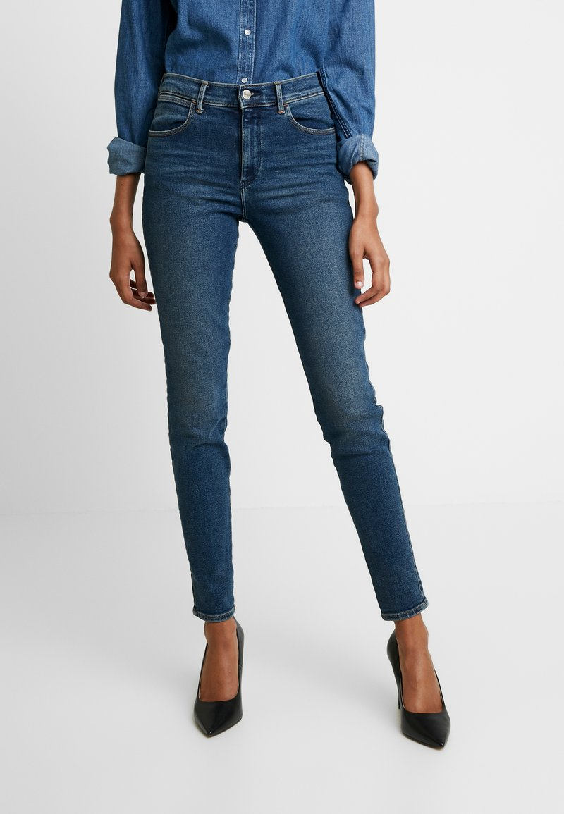 Wrangler - HIGH RISE - Jeans Skinny Fit - used tint