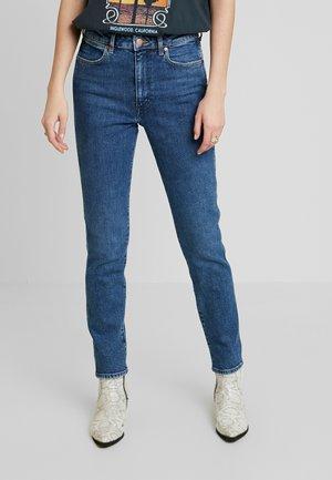 RETRO - Slim fit jeans - indigo mid